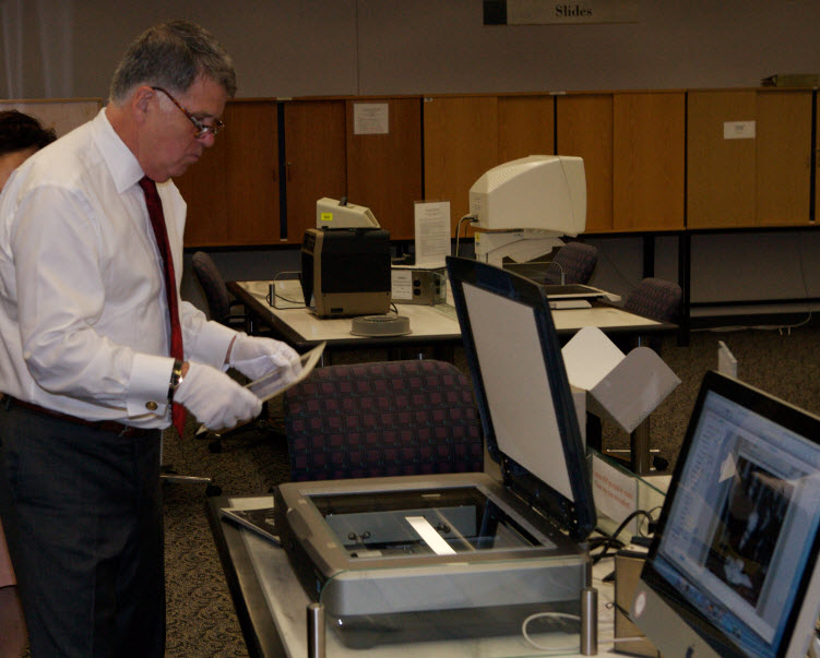 The Archivist Scanning Images
