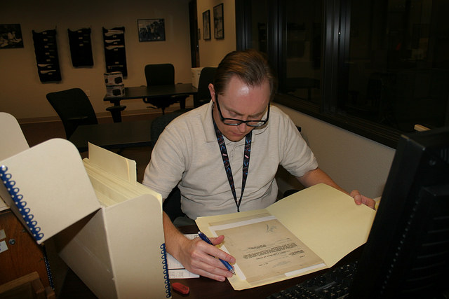 Archivist reviewing documents