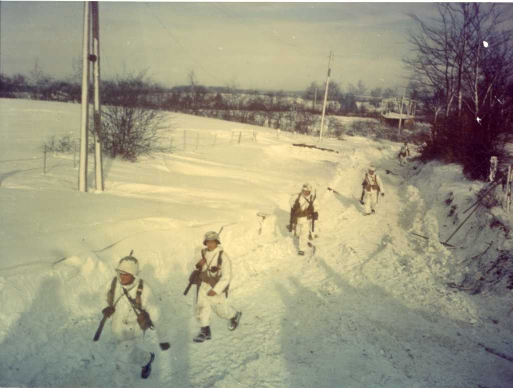Yanks Trudge through Snow from Humpange,Belgium to St. Vith