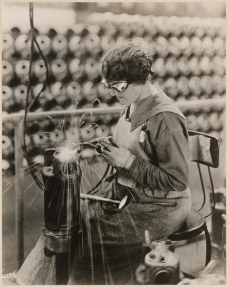 Liberty motors manufactured for government use. Electric welding on the steel jacket on a Liberty Motor cylinder. Lincoln Motor Co. plant. Detroit, Michigan. National Archives Identifier 45567610