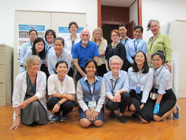 Members of the Queen Sirikit Museum of Textiles exhibit loan international install team pose in Bangkok, Thailand